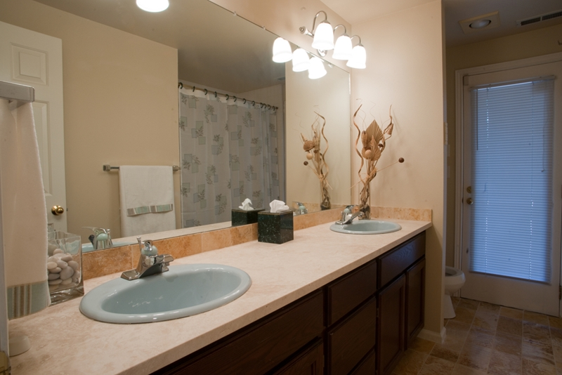 A plain mirror without a frame can give your bathroom an unfinished look.